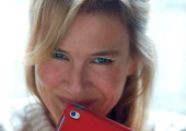 Bridget Jones swaps a diary for an iPad in the first photo from 'Bridget Jones's Baby'